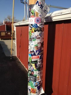A pole of stickers at the StickerGiant Headquarters