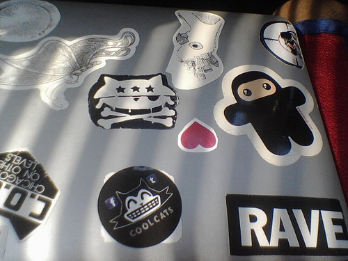 A laptop computer covered with cool stickers.