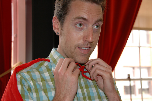 Man in a Plaid Shirt with a Red Cape for Article on Top Places to Find Jobs Online