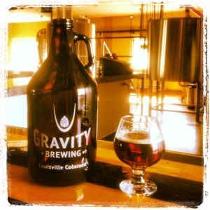 gravity-brewing-company-sticker-story-pic-with-growler-and-anice-filter-with-pint-glass-sitting-on-bar