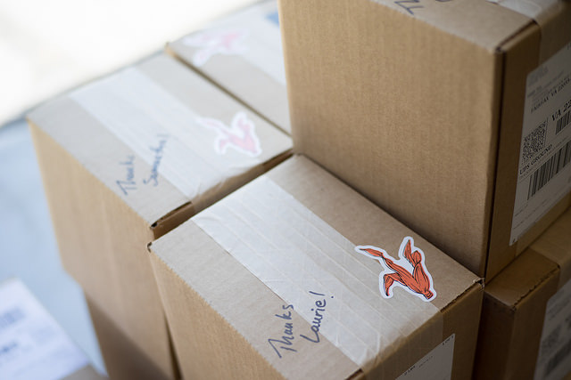 quinn popcorn stickers on shipping boxes