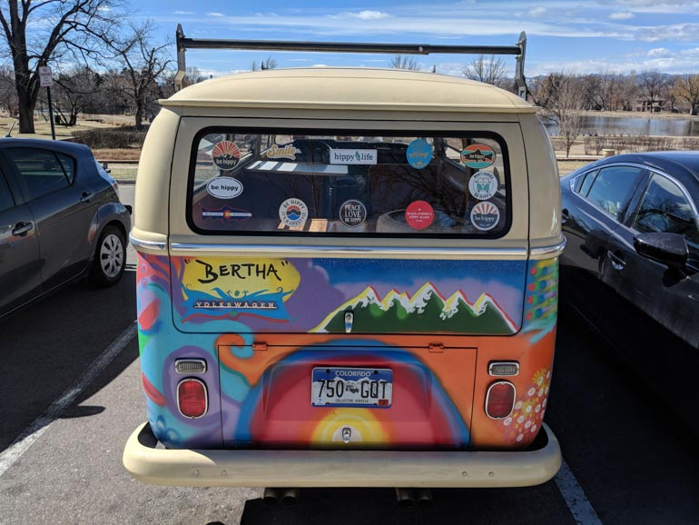 Bertha-the-Be-Hippy-van-with-custom-stickers-and-Colorado-inspired-artwork