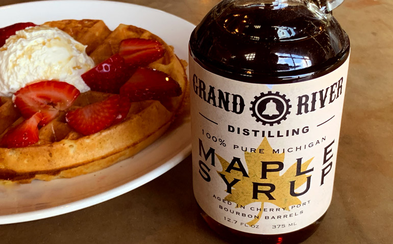 Grand-River-Distilling-Shows-their-Product-Label-Printed-by-StickerGiant-on-a-Maple-Syrup-Bottle-with-Waffles