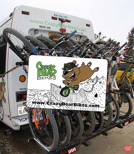 Custom-Logo-Stickers-for-Crazy-Bear-Bikes-with-Bike-Tour-Bus-in-Background